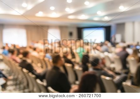 Blurry Background Speaker On Conference Stage With Projector In America