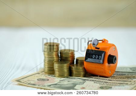 Tally counter or counting machine with 0000 number, coin and banknote, business and finance concept idea. stock photo