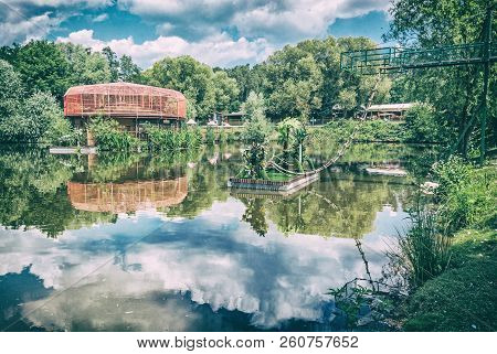 Zoological garden area in Bojna village, Slovak republic. Pond with reflections scene. Travel destination. Analog photo filter with scratches. stock photo