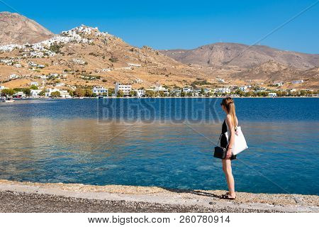 Young woman admiring beautiful hills of Serifos island. Cyclades stock photo