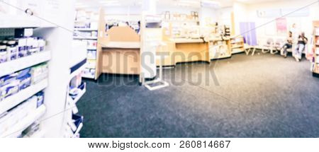 Vintage tone blurred image senior gentlemen at pharmacy pickup area, prescription pick up at drugstore in America stock photo