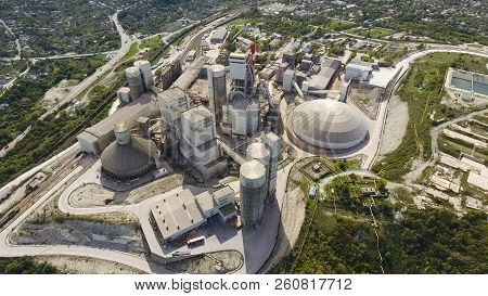 Verkhnebakansky cement plant, top view. Factory for the production and preparation of building cement. Cement industry. stock photo