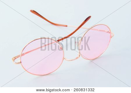 Round Italian sunglasses on white background. Pink eyeglasses. Modern protective eyewear shades. Eye UV protection accessories stock photo
