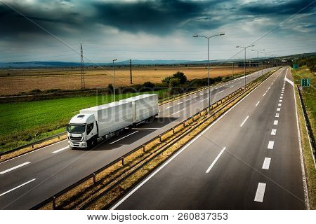 Highway transportation with white lorry a Cloudy Day stock photo