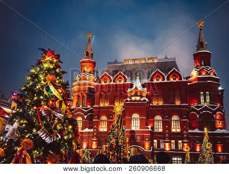 Decorated Christmas trees in honor of the Shrovetide week in Moscow near the Red Square Historical Museum. Beautiful Holiday scenery with holiday decorations christmas trees, colored ribbons, bagels, and rag dolls. stock photo
