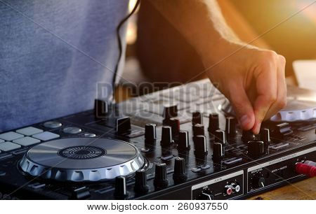 DJ plays and mix music on digital midi controller. stock photo