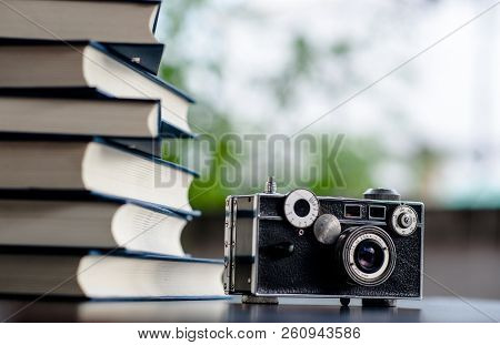 Book and Camera Put on the floor. White leather Book and study The concept of empathy and development stock photo