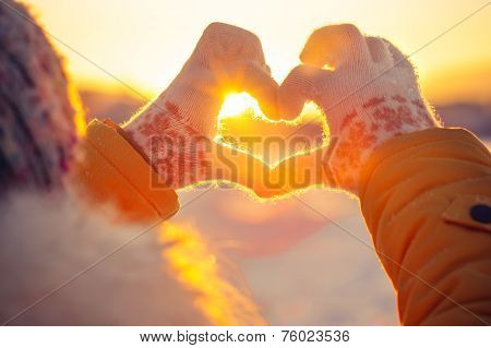 Woman hands in winter gloves Heart symbol shaped Lifestyle