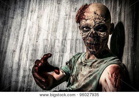 Close-up representation of an unpleasant frightening zombie man. Ghastliness. Halloween.