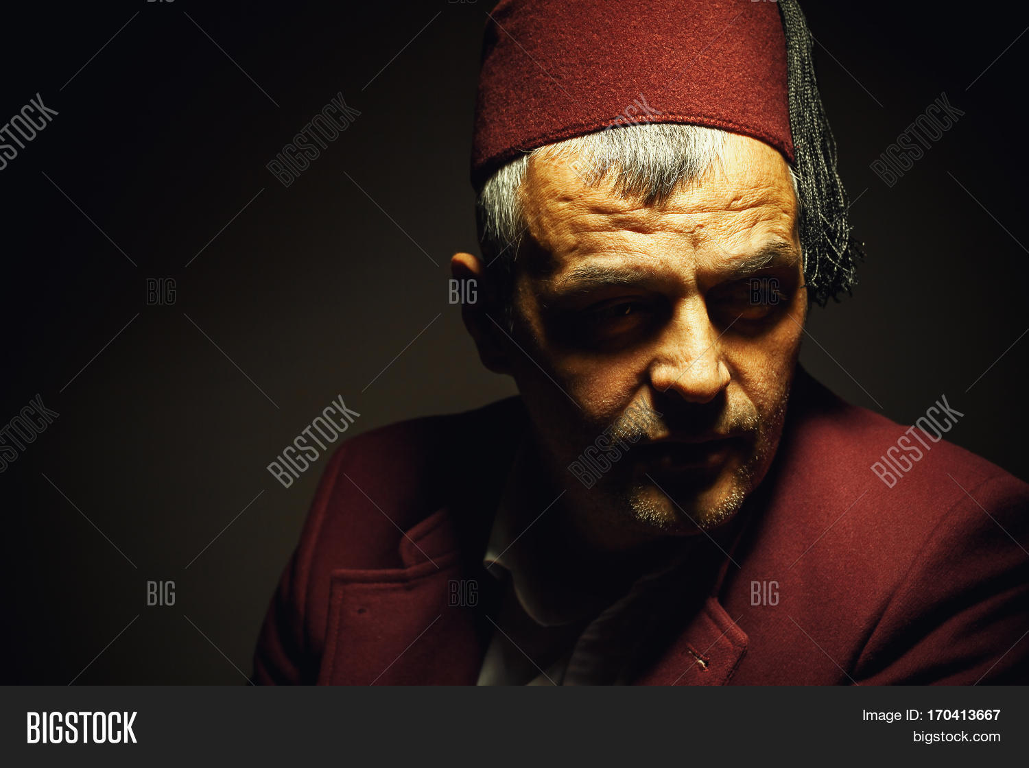 Balkan,Bosnian,Macedonian,Muslim,Serbian,Turkish,act,adult,age,body,cap,closeup,clothes,concept,conceptual,custom,decorative,dressing,expression,eyes,facial,fashion,fez,folk,folklore,hat,head,hear,heritage,life,lifestyle,man,middle,object,original,portrait,pose,red,shoulders,still,studio,tapan,tarboosh,traditional,unique,view