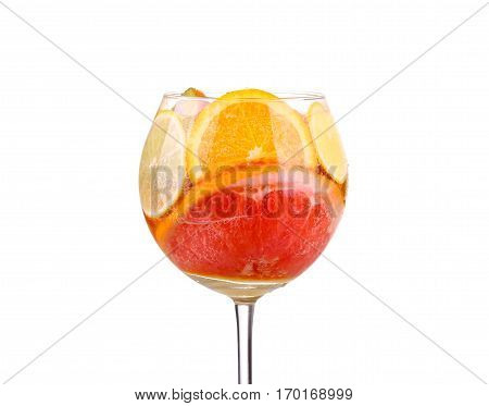 pitcher with a refreshing drink with lemon slices of orange and kiwi on white background stock photo