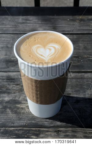 Latte. Coffee Latte with a heart shape in the foam for Valentines Day. stock photo