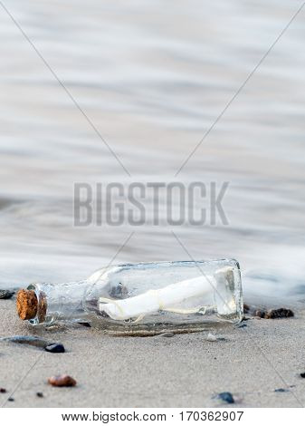 Message in the bottle washed ashore stock photo