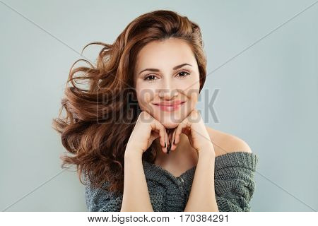 Smiling Woman with Red Curly Hair. Happy Redhead Model Pretty Face