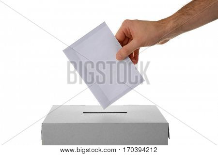 Male hand putting voting ballot into the box  on white background stock photo
