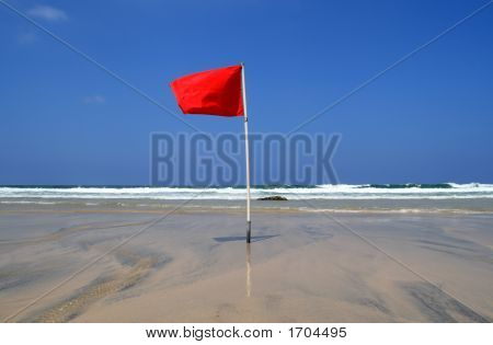 A red dangerous swimming warning lifeguard flag. stock photo