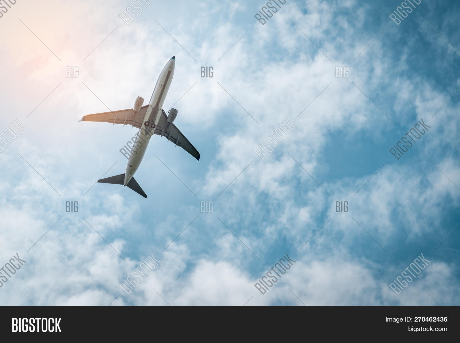 Commercial Airline. Passenger Plane Takes Off At Airport With Beautiful Blue Sky And White Clouds. L