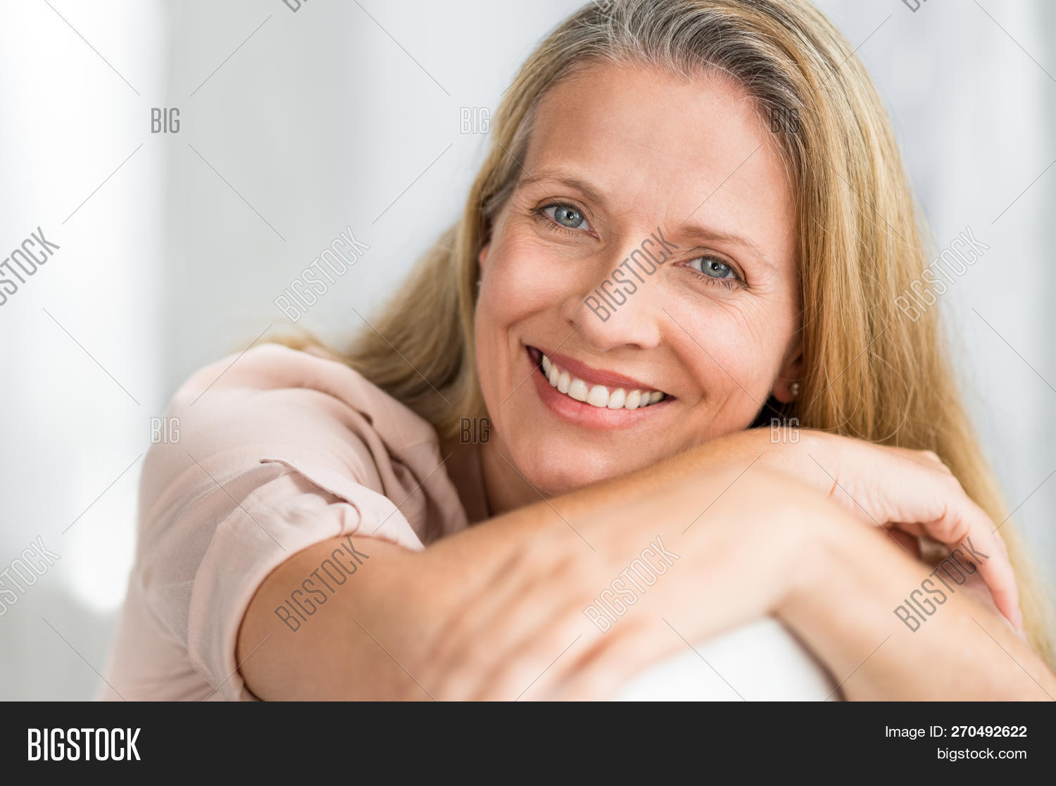 age,aged,aged care,aging process,attractive,beautiful,blonde,blonde hair,carefree,caucasian,cheerful,contemplation,couch,dental,elderly,face,happy,imagination,indoor,lady,leisure,looking,looking at camera,mature,mid adult woman,middle,middle aged woman,portrait,positive,positive attitude,proud,relax,relaxed woman,retired,retirement,satisfaction,satisfied,senior,serene,sitting,smile,sofa,teeth,thinking,toothy,toothy smile,whiten,whitening,woman,wrinkle
