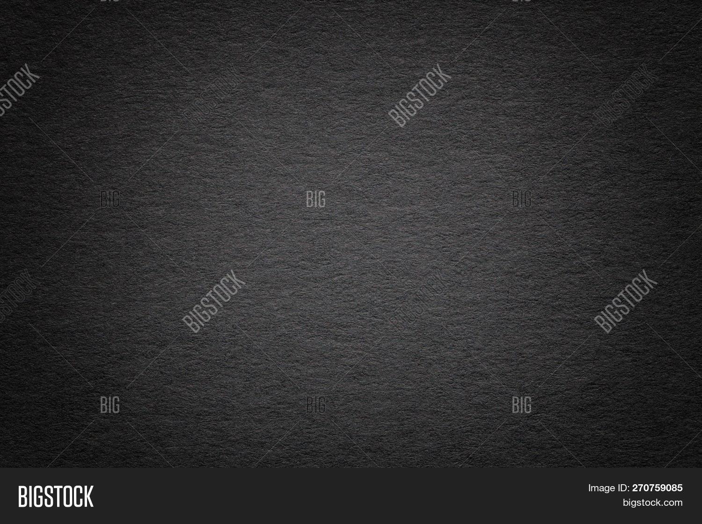 Texture Of Vintage Dark Black Paper Background With Vignette. Structure Of Dense Gray Kraft Cardboar