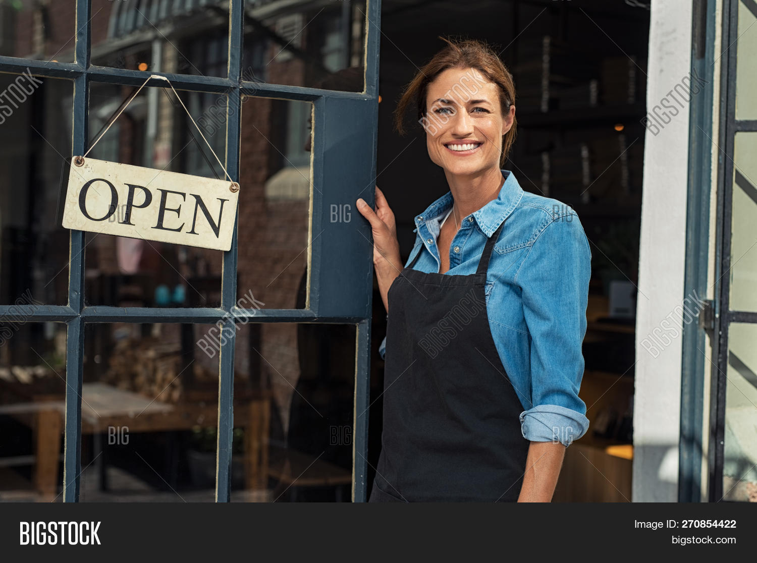 40s,apron,attractive,business,cafe,cafeteria,cheerful,coffee,coffee shop,confident,door,doorway,entrepreneur,food,friendly,happy,looking,looking at camera,mature,mid,mid adult woman,middle aged woman,new,occupation,open,open sign,owner,people,portrait,pride,proud,proud woman,restaurant,satisfied,service,shop,sign,small,small business,smile,staff,standing,success,successful,toothy smile,waitress,wearing apron,woman,work,worker