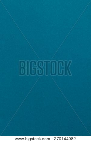 Vertical creative blue blank mockup from color textural design cardboard for smartphones vertical templates. Vertical mockup of designer blue paper. Portrait mockup with space for an inscription. stock photo