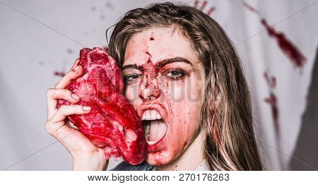 Steak concept. Hungry woman with meat steak. Hungry emotional angry woman screaming. A sensual bloody woman want eat. Hungry and angry faces. Crazy horror story. Sexy kitchen and juicy steak stock photo