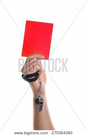 Football referee with whistle holding red card on white background, closeup stock photo