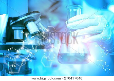 Health Care Researchers Working In Life Science Laboratory. Young Female Research Scientist Analyzin
