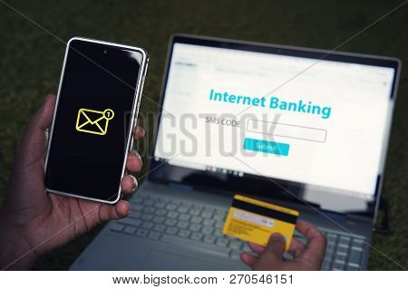 Internet Banking Online Payment Technology Concept. Came SMS password from your personal account mobile phone to enter the online Bank. online banking is protected by an individual password stock photo
