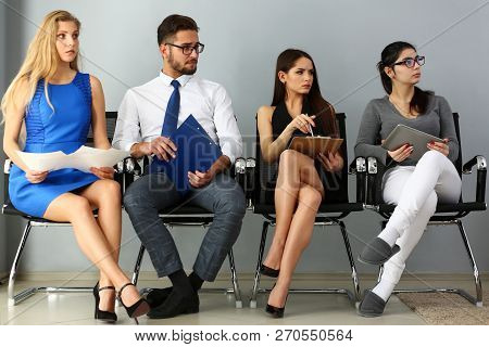 Group of people sit on casting chairs row at boss reception. Curriculum vitae queue participation human resource cv application social engineering competitor hr recruit visitor for job offer stock photo