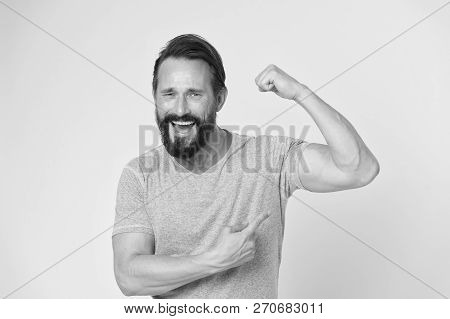 fitness result. man show on muscle as result after fitness training. fitness result of happy man. man pointing on biceps showing fitness result. workout results stock photo