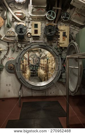 closely inside the submarine, round hatch in the engine room stock photo