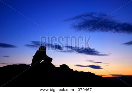 a person thinking on a beutiful sunset stock photo