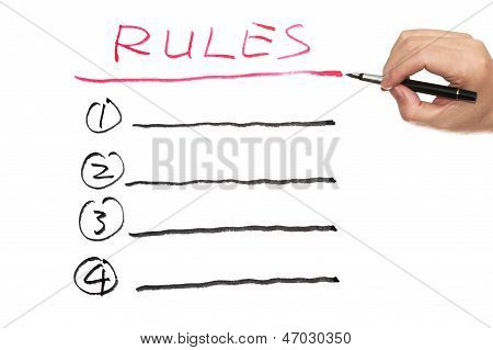 Rules list written on the white paper stock photo