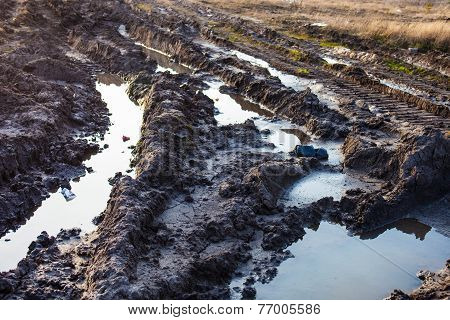 Mud and puddles on the dirt road. stock photo