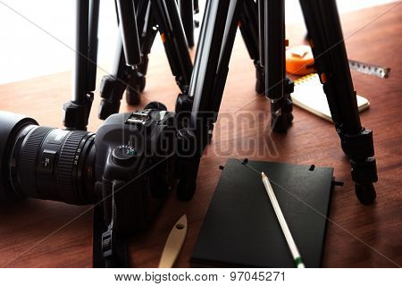Tripods and DSLR camera. Prepared for taping or photograph session. Photography gear.