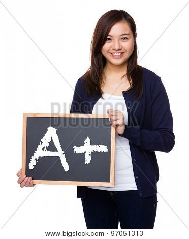 Woman showing the chalkboard with a A plus mark stock photo