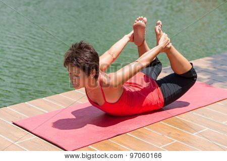 Japanese beauty woman practicing bow pose outdoors stock photo