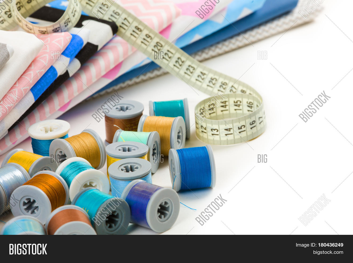 apparel,assortment,background,blank,casual,clean,closeup,cloth,clothes,clothing,color,colored,colorful,concept,cotton,diy,fabric,fashion,folded,garment,group,heap,housework,ironed,kitchen,linen,material,measurement,napkin,nobody,object,pattern,pile,pressed,raw,red,sewing,spool,stack,style,table,tablecloth,tailored,tailoring,tape,textile,thread,top,white,yellow