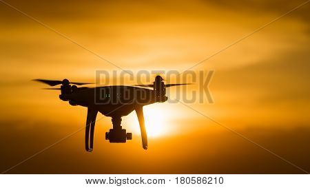 drone quad copter with digital camera at sunset ready to fly for surveillance. close-up of Rotor drones. 4 blade propeller drone. silhouette drone on sunset. Drone Video Camera.