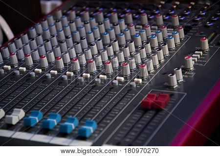 Sound mixer. Professional audio mixing console with lights buttons faders and sliders. stock photo
