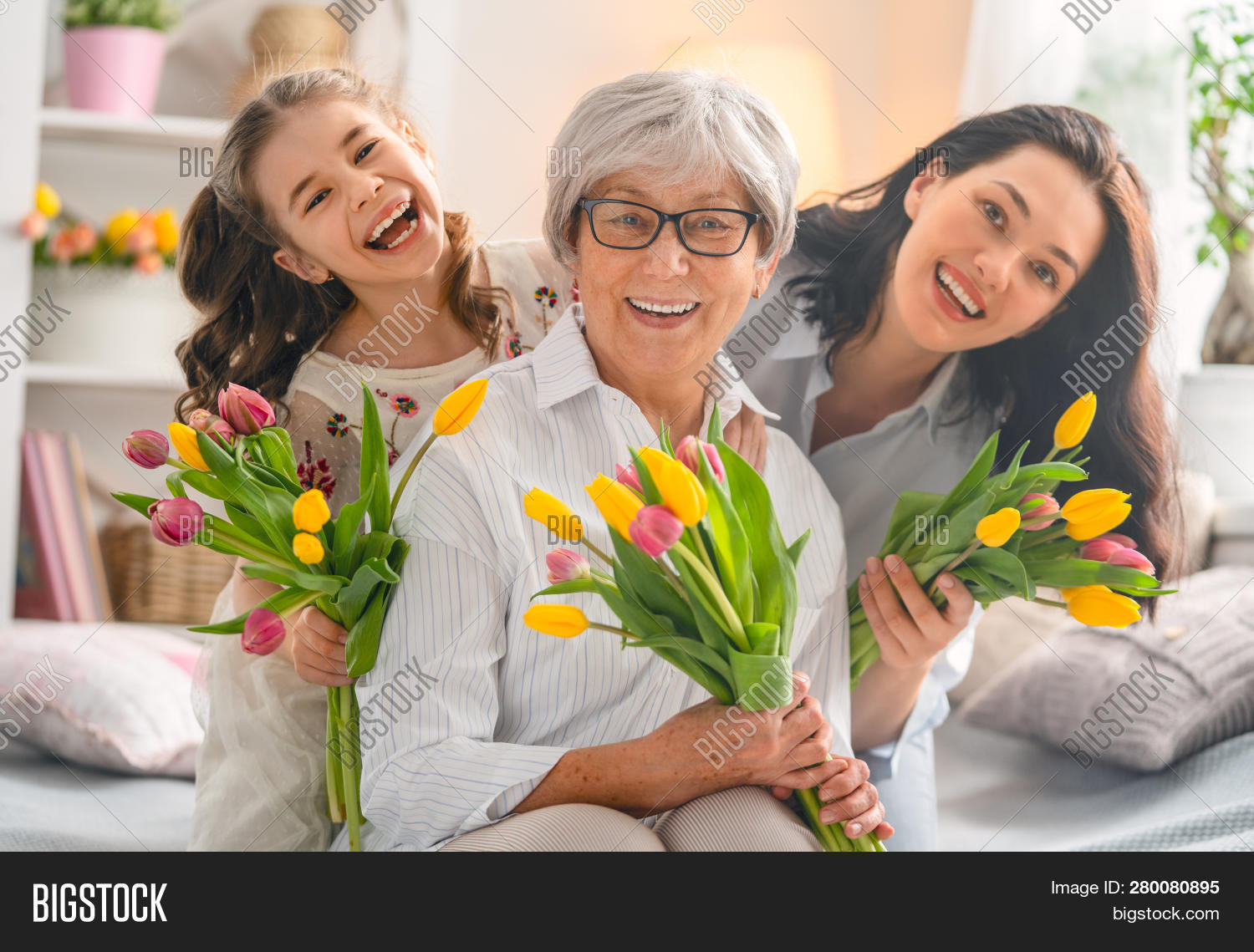 8,adult,bouquet,care,caucasian,child,childhood,daughter,day,eighth,embrace,family,female,flowers,fondness,generation,gift,girl,giving,grandma,grandmother,granny,happiness,happy,healthy,home,hugging,indoors,international,kid,laugh,lifestyle,love,lovely,march,mom,morning,mother,mum,parent,parenting,people,playing,room,smiling,sunlight,together,tulips,woman,young