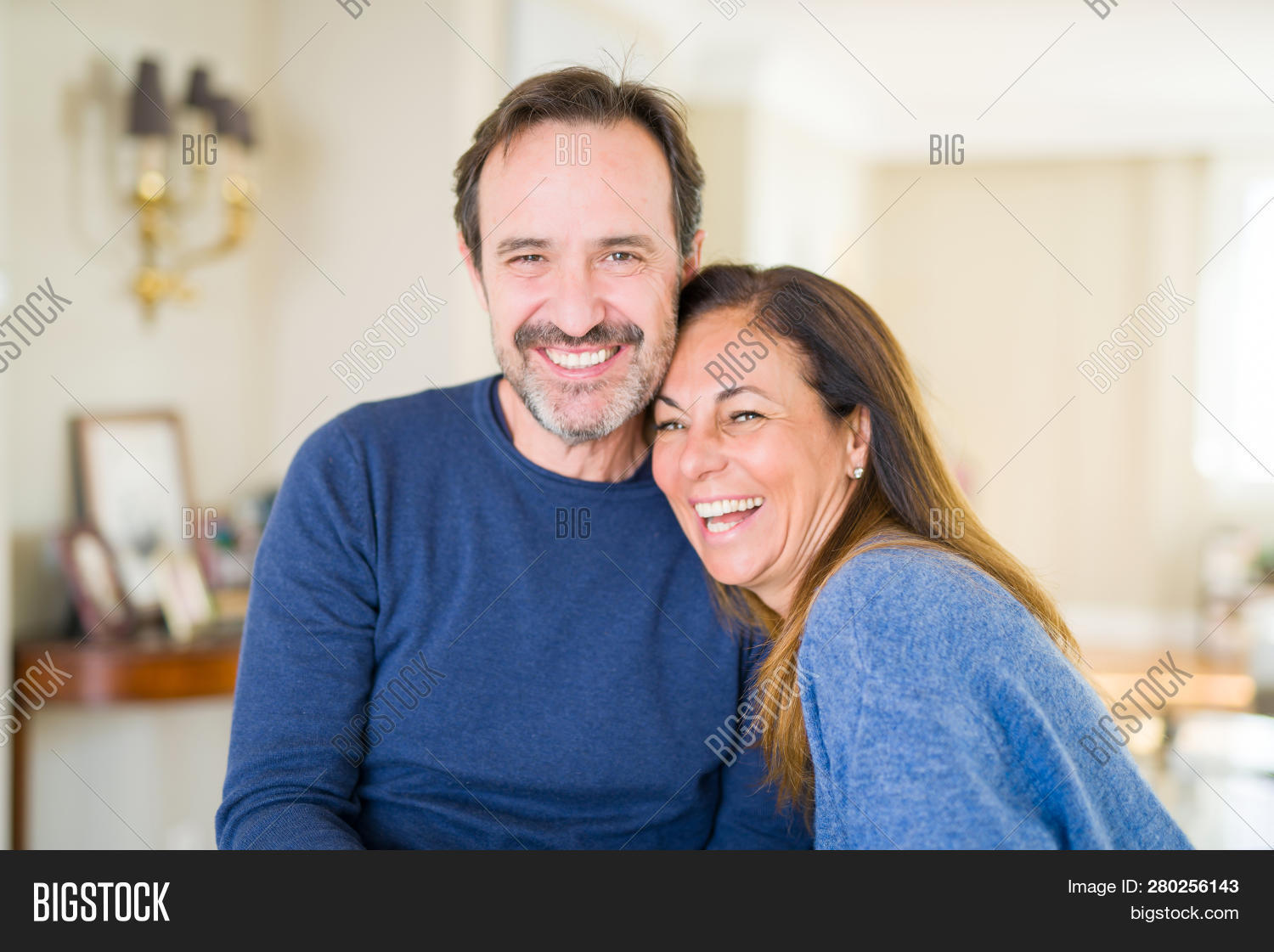 40,50,adult,affection,age,aged,beautiful,caucasian,cheerful,couple,elderly,expression,family,gesture,grey,hair,handsome,happy,healthy,home,house,husband,indoor,lifestyle,looking,love,man,mature,middle,middle age,old,people,person,portrait,relationship,retirement,romance,romantic,senior,sitting,smile,table,teeth,together,two,white,wife,woman,years
