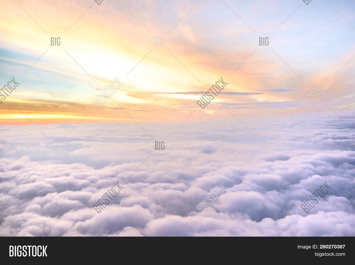 above,abstract,air,atmosphere,backdrop,background,beautiful,beauty,blue,bright,brightly,clear,climate,cloud,cloudscape,cloudy,copy,cumulus,flight,fluffy,fly,freedom,heaven,high,idyllic,landscape,light,meteorology,natural,nature,outdoor,over,ozone,plane,scene,scenery,scenic,sky,softness,space,sun,sunbeam,sunlight,sunny,sunshine,top,tranquil,view,weather,white