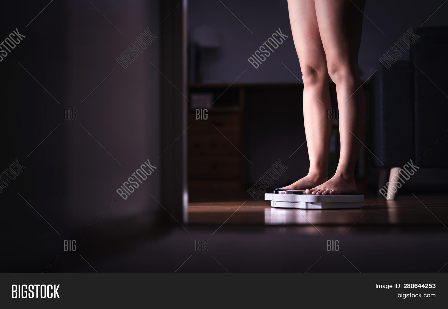 Lady Standing On Scale. Weight Loss And Diet Concept. Woman Weighing Herself. Fitness Lady Dieting.