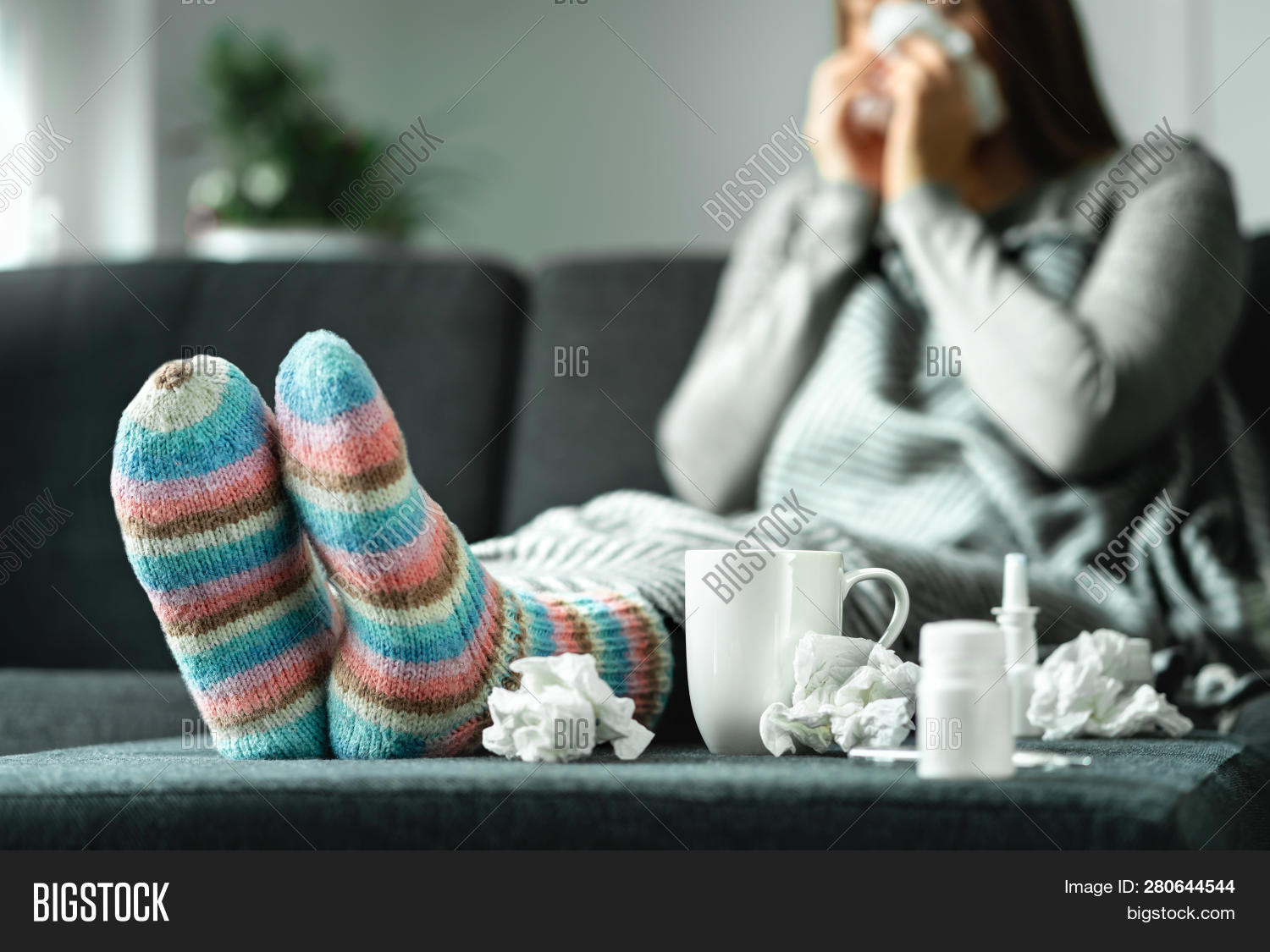 adult,beverage,blanket,blow,blowing,cold,couch,cough,drugs,female,fever,flu,grippe,handkerchief,health,home,hot,ill,illness,infection,leave,medical,medicine,nasal,nose,paper,people,person,remedies,rest,resting,rhinitis,sick,sitting,sneeze,sniff,sock,sofa,spray,stocking,table,temperature,thermometer,tissue,towel,virus,winter,woman,woolen,young