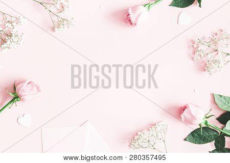 Valentine's Day Composition. Pink Rose Flowers, Envelope On Pastel Pink Background. Valentines Day,