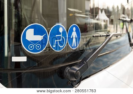 New modern bus on LPG. International Symbol of Access - Wheelchair Symbol (handicapped, physically challenged and disabled), Baby Stroller Symbol and Elderly (Old) People Symbol on the windshield. stock photo