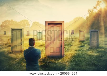 Rear View Man In Front Of Many Different Doors Choosing One. Difficult Decision, Concept Of Importan