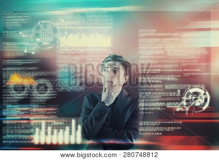 Businessman analyze data from a futuristic media interface. stock photo